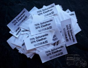 50 Textiletiketten 70% Schurwolle 30% Elasthan