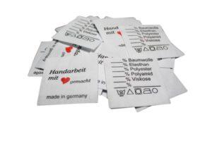 25 Textiletiketten Universal - Handarbeit mit Herz gemacht - 30° - Mischband