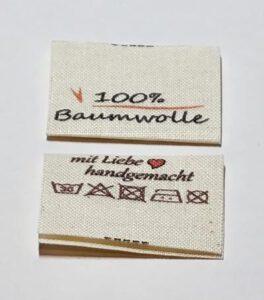 GOTS Label, Etiketten auf Naturbaumwolle, Öko-Tex zertifiziertes Band in naturfarben, mittig gefalten