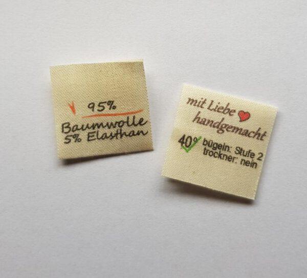 100% Bauwolle, Textiletiketten mittig gefalzt, Lizenzfrei