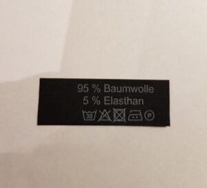 schwarzes Label mit weißem Aufdruck Baumwolle - Elasthan Restposten