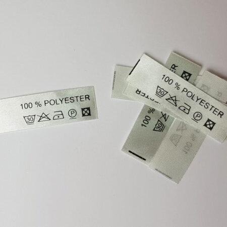Textiletiketten, 50 Stück *silbergrau* Aufdruck: 100% Polyester