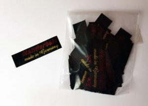 Made in Germany Textiletiketten zum Einnähen, 2-farbig bedruckt in Glanzfarben auf Satin, schwarz.